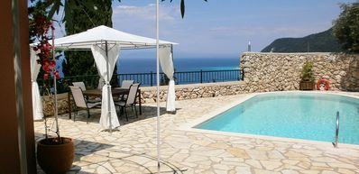 Photo for Beautiful Villa with AC, Private Pool, Uninterrupted Sea & Sunset Views only 600 m to Agios Nikitas!