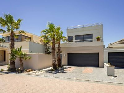 Photo for Home away from home on a secure golf estate, situated next to the ocean and golf