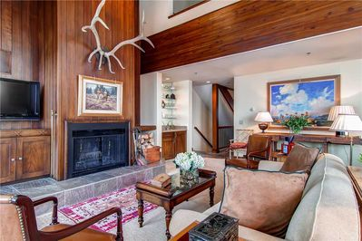 Warm and welcoming living room wood burning fireplace large screen TV - Park City Lodging-Little Belle 8