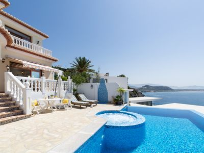 Photo for Luxury villa right on the coast with private pool and phenomenal view