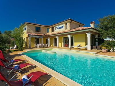 Photo for This 4-bedroom villa for up to 8 guests is located in Vodnjan and has a private swimming pool, air-c