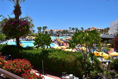 View from the terrace to the large pool area and to the sea