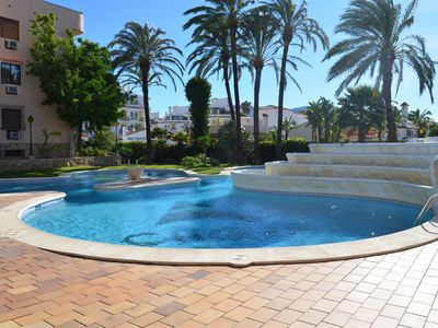 Photo for Penthouse with elevator, sea, communal pool, 2 bedrooms, air conditioning, BBQ