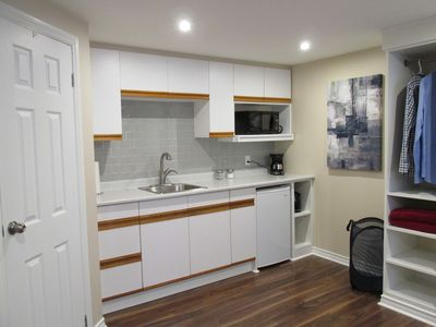 The kitchen has a mini fridge, microwave oven, toaster, coffee maker, and kettle