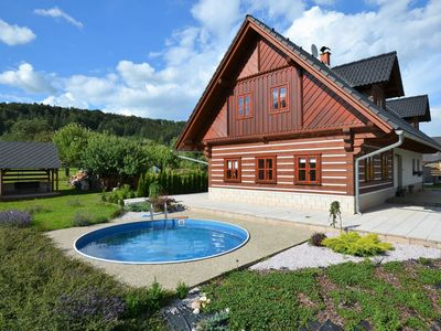 Photo for Apartment in a log cabin-style with pool and a covered terrace in the fenced garden