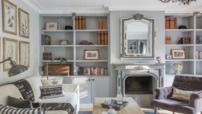 Decorative fireplace mantle and bookshelves in living room