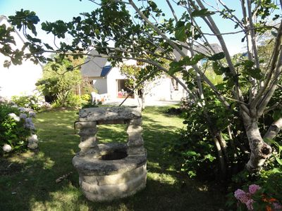 Photo for Pretty Cottage standing stones in a beautiful flower garden near the beach