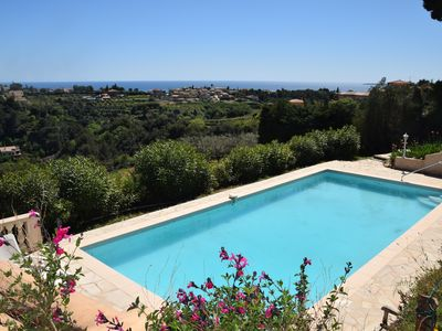 Photo for Exceptional sea view apartment, with pool, 10 minutes from Nice and beaches