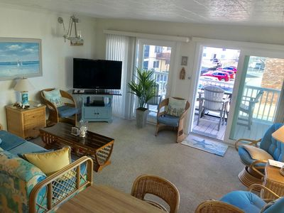 Large 3 bedroom condo with great beach vibes, has free WiFi and large balcony with partial ocean view, located in midtown on the ocean block, just steps to the beach!
