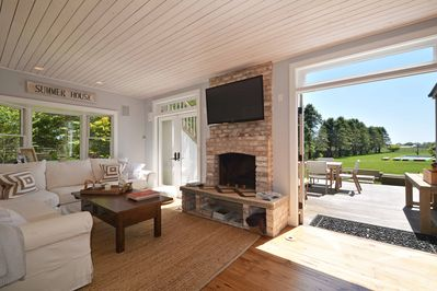 Living Room with Deck. Indoor/Outdoor Fireplace and Sonos music system.