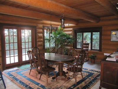 Large dinning area with BBQ and wrap around porch.