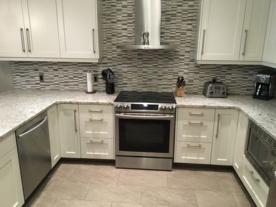Gourmet Kitchen Fully Equipped with Stainless Steel Appliances