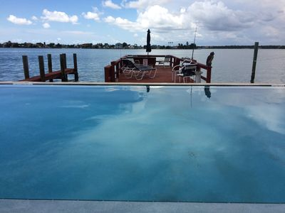 Relax in our heated waterfront pool