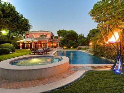 Photo for OUTSTANDING 5 BEDROOM VILLA WITH JACUZZI, HEATED  POOL, GAMES ROOM  IN QUINTA DO LAGO DM12