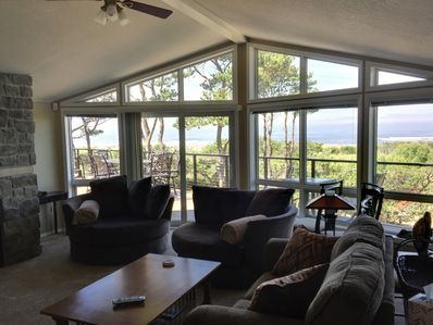 Upstairs living room with 2 huge barrel chairs, looking West towards the ocean.