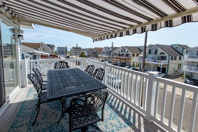 16-foot automatic retractable awning and dining table on the top deck.