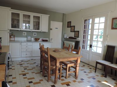 Kitchen opens onto enclosed gardens