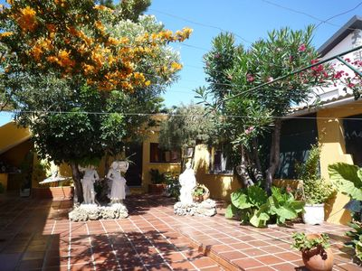 Photo for Cozy Portuguese house with beautiful private courtyard near the sea