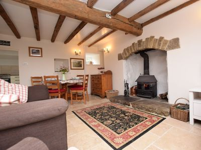 Spacious open plan living with cosy wood burning stove