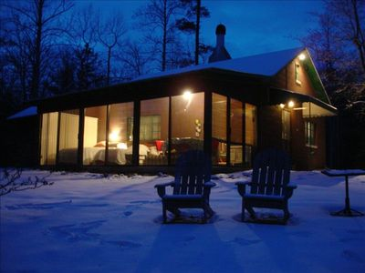 Cozy sleeping porch gives you a view of the creek on all  three sides.