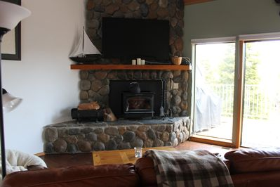 Family room with wood stove and flat screen T.V.