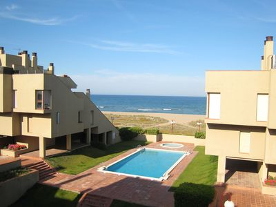 Photo for Nice apartment in Spanish style with communal swimming pool and at the beach