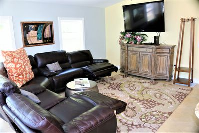 "Enjoy the 65""  TV From Comfy Electric Leather Recliners"