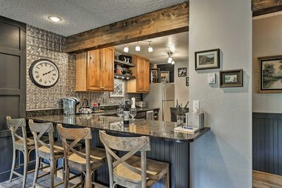 Prepare a cup of Keurig coffee and sit down at the 4-person breakfast bar.