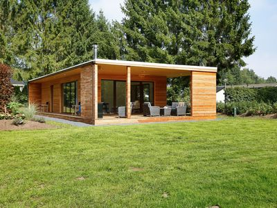Photo for Attractive lodge with veranda, outdoor fireplace
