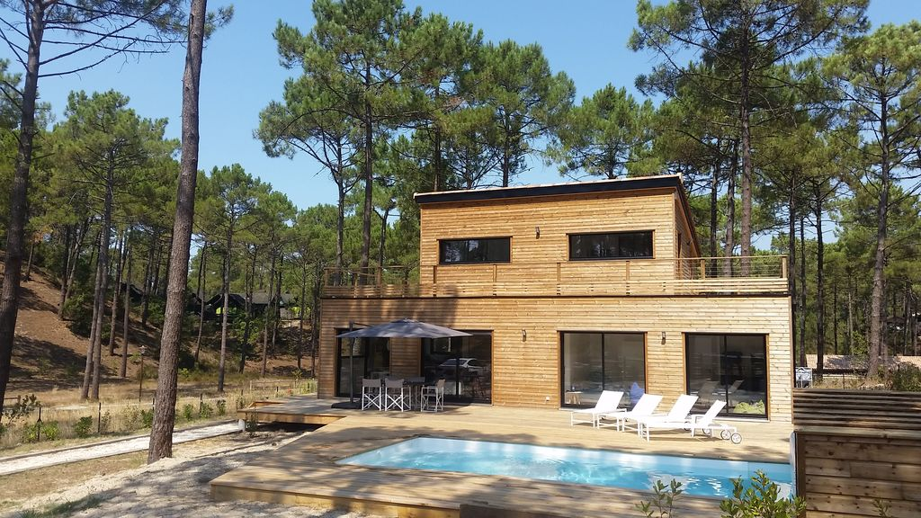 maison bois maubuisson au calme en for t 8 personnes avec piscine chauff e carcans. Black Bedroom Furniture Sets. Home Design Ideas