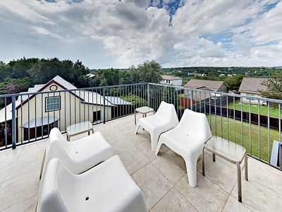 Deck - Lounge and relax in the sun on a rooftop deck right off the game room.