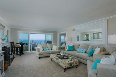 Living room opens to oceanfront patio deck