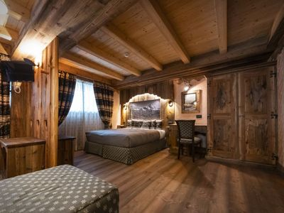 Photo for Catered chalet with private spa, jacuzzi and sauna, walking distance from slopes and Cervinia center