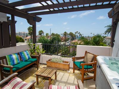 Photo for Totally Tricked Out! Hottub,A/C,Bikes,HDTV/Music,Spacious,4min walk to beach.