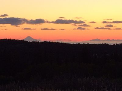 Sunset view of Cook Inlet and the volcanoes, taken from the cabin deck.