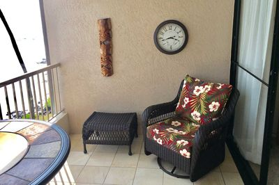 2  comfy swivel chairs with ottomans on lanai - perfect for watching the waves.