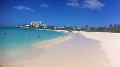 Mullet Bay Beach. White sands and azure blue waters.
