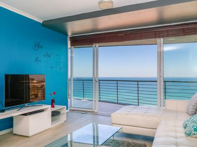 Photo for Apartment w/ amazing ocean view, balcony & shared pool - steps to beach!