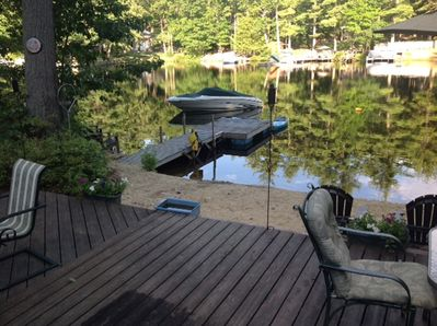 Private sandy beach with dock & large deck