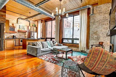 Flat Loft- 1 BR/1 BA with sun flooded living area with fireplace
