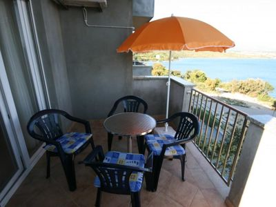 Photo for Two bedroom apartment with terrace and sea view Posedarje (Novigrad)