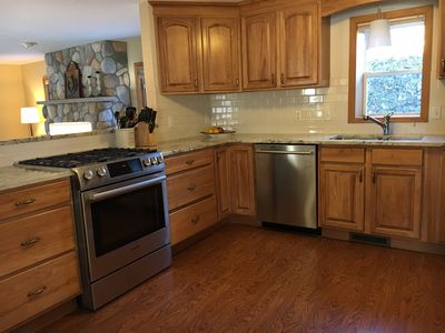 Gourmet kitchen with new appliances and granite counters. Ideal for entertaining