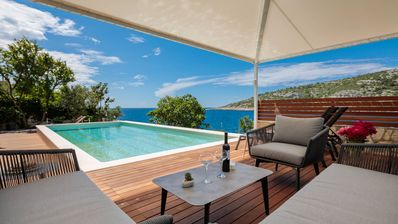 Photo for Luxury villa with heated pool, 15m from the sea, complete privacy