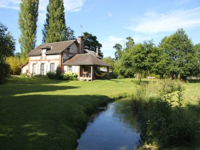 Photo for A quaint house set on anislet by the samll fishing river called the Andelle, in the heart of the Pays de Bray