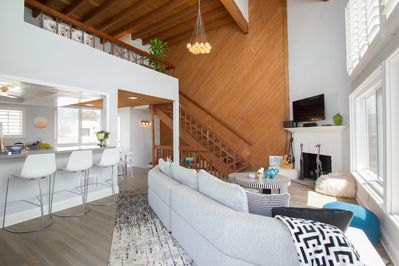 Vaulted ceilings with exposed beams sure to make anyone feel at home.