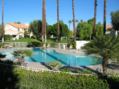 View of the pool, there is an entry gate to the pool from the patio