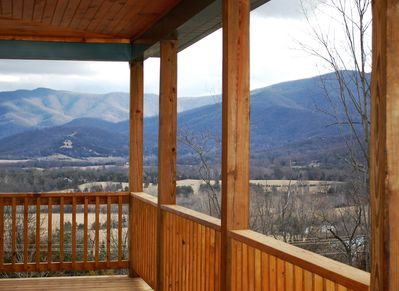 Wrap-around upper decking & lower patio w/hot tub, fire pit & propane grill.