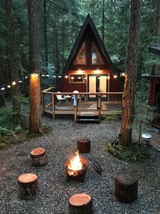 outside at dusk with fire pit