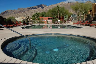 Pool and spa with mountain view