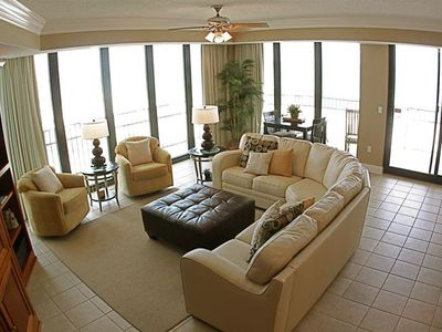 Living room with two floor to ceiling glass walls ... breath taking view.